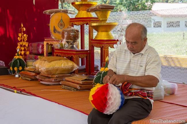 man decorating tent for Kathin celebration