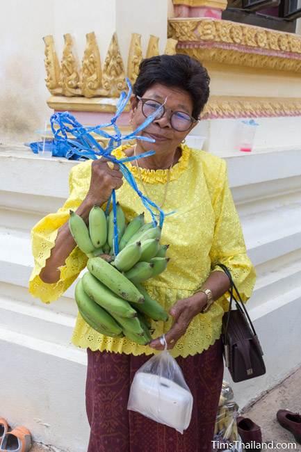 woman holding bananas for Kathin celebration