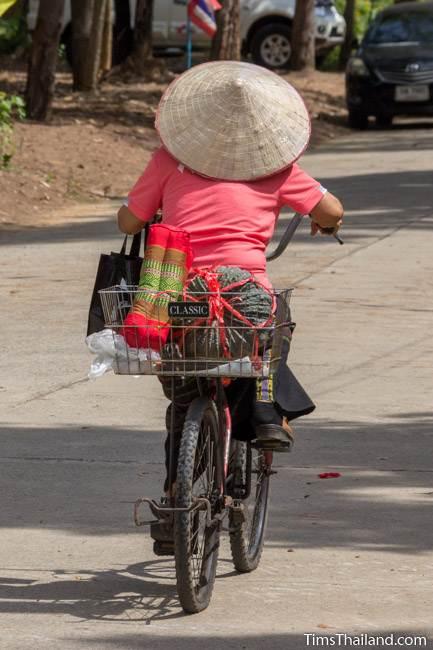 woman riding bike after Kathin celebration