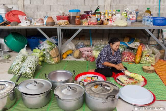 woman cutting papaya for making food for Kathin celebration