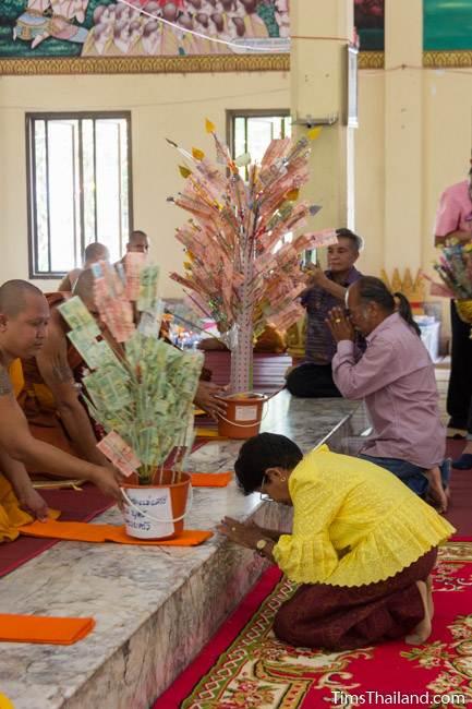 presenting money to monks for Kathin celebration
