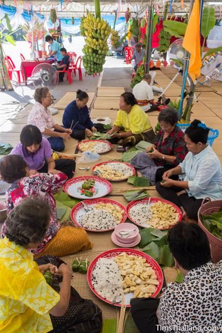 group of women making khao tom mat for Kathin celebration