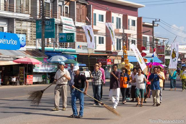 people walking in Kathin celebration parade