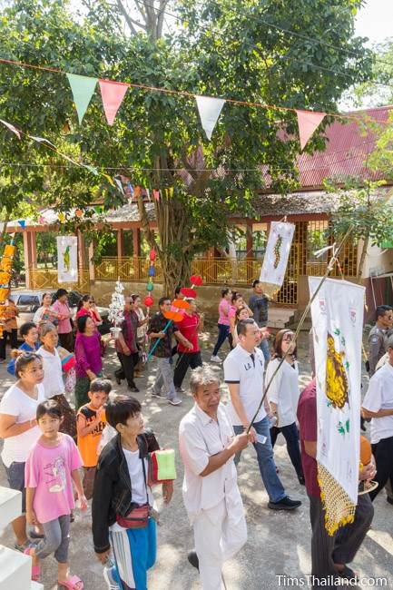 people walking around temple for Kathin celebration