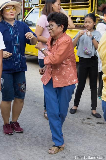 woman dancing in Kathin celebration parade