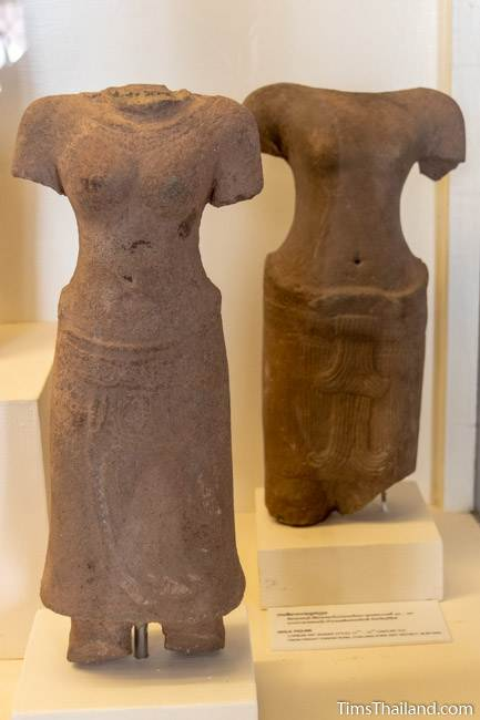 headless and armless bodies of devi goddess and male figure from Phanom Rung Khmer ruin at Maha Viravong National Museum
