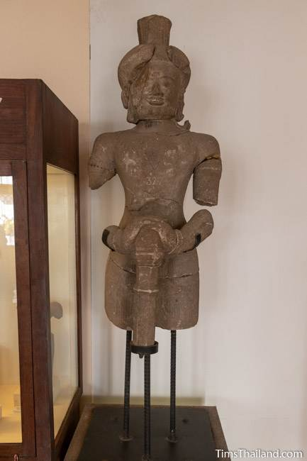 armless and legless dvarapala statue from Prang Krathin Khmer ruin at Maha Viravong National Museum