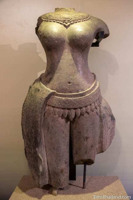 headless and limbless female deity stone carved statue