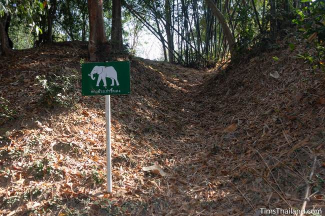 sign at rampart saying old elephant trail at Muang Boran Dong Lakhon