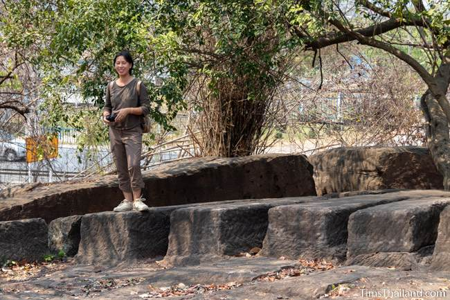 woman standing on sandstone blocks not yet removed