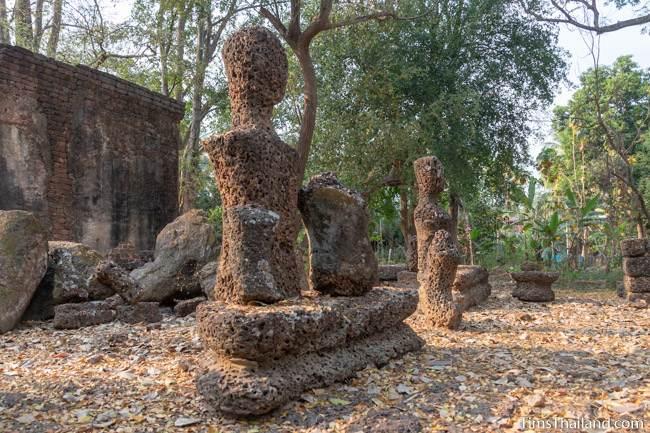 crumbling laterite Buddhas