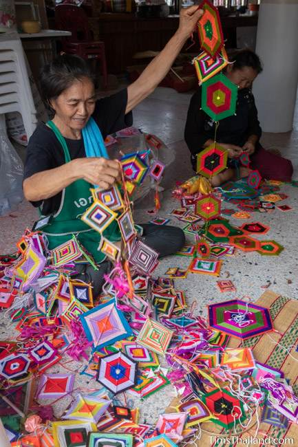 woman sorting decorations