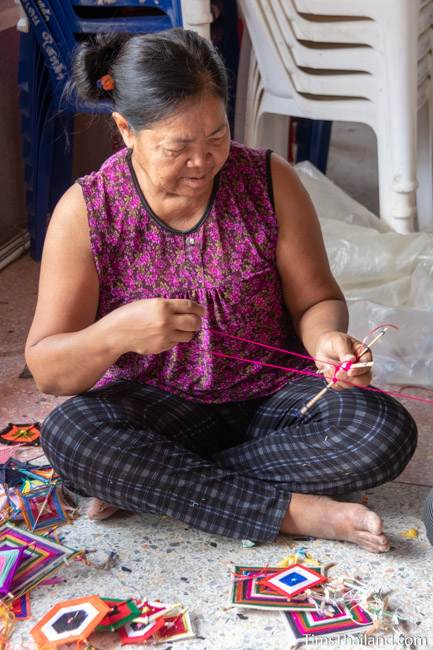 woman making decoration out of yarn