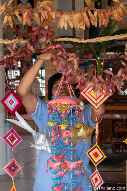 woman hanging decorations