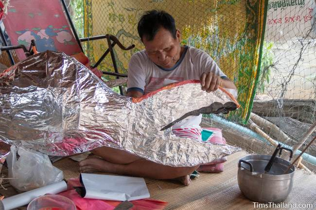 man making fish decoration