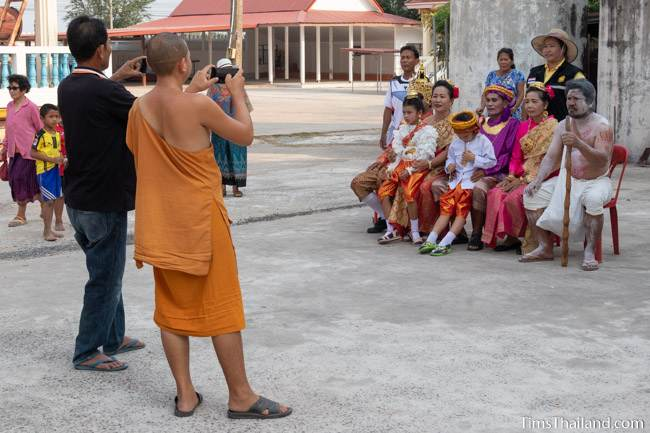 monk taking photo of Vessantara and his family
