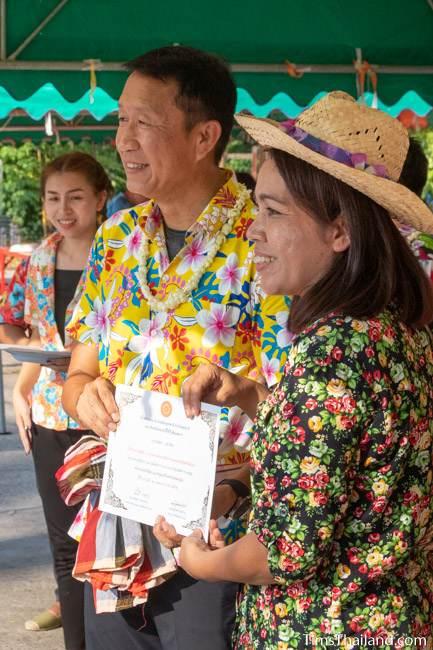 teacher receiving certificate