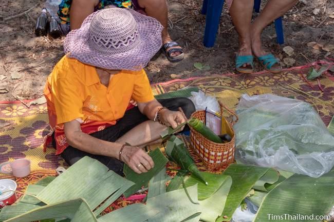 woman cutting banana leaves