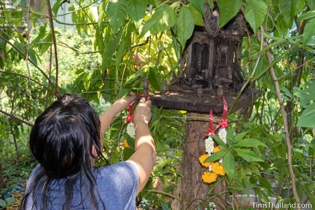 hanging flower garlands on spirit house