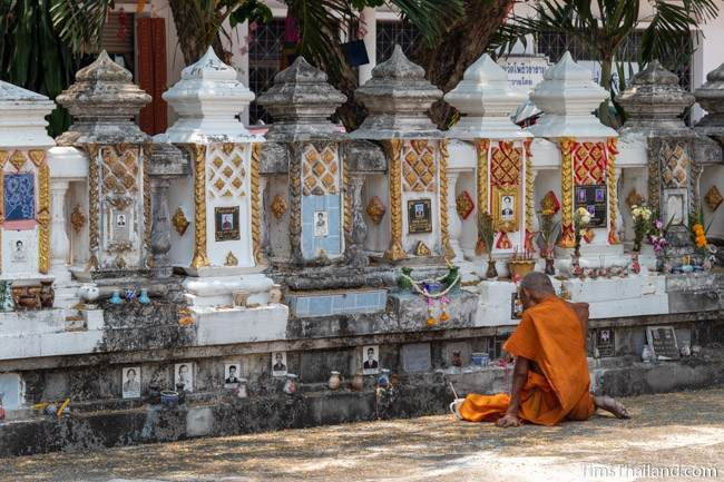 monk with ancestor vault at temple