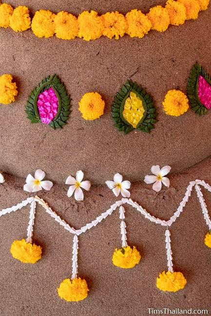 close-up of flowers on a finished sand stupa