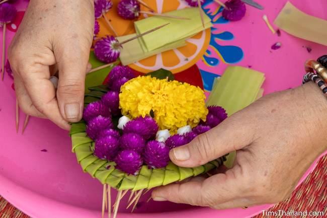 preparing flowers for sand stupas