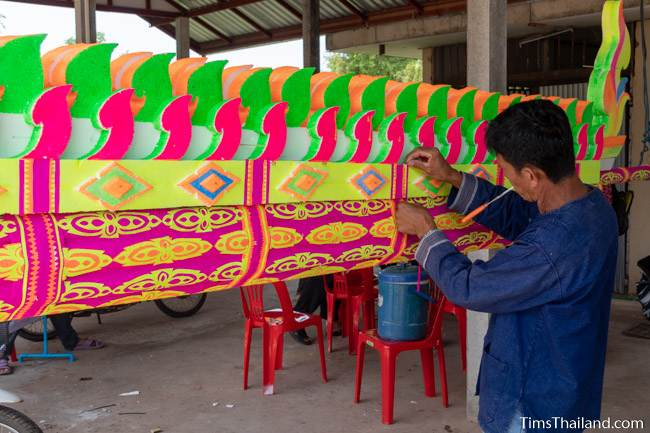 decorating a colorful parade float