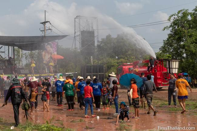 fire truck spraying water on crowd at mo lam concert