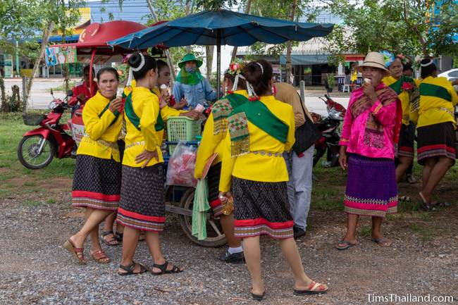 women in Thai traditional clothes eating ice cream