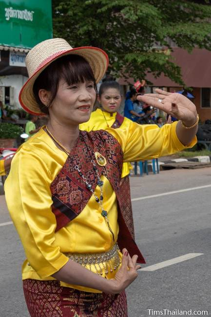 woman in Thai traditional clothes dancing in the parade