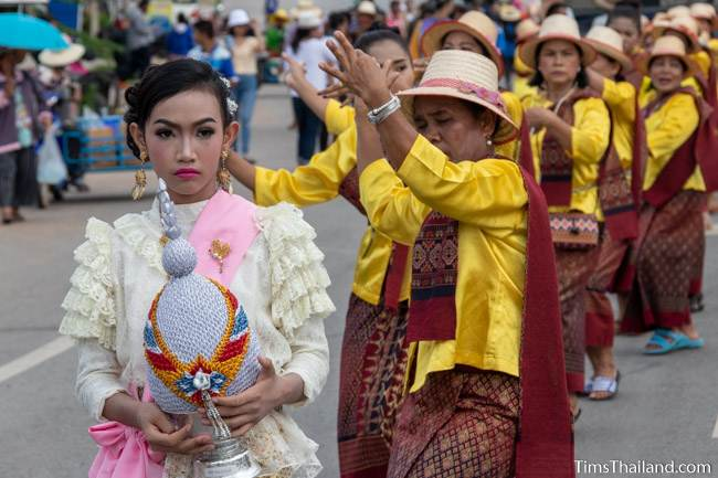 women in Thai traditional clothes dancing in the parade
