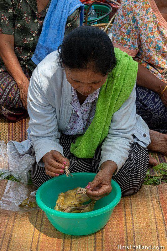 women pulling bone out of chiclen