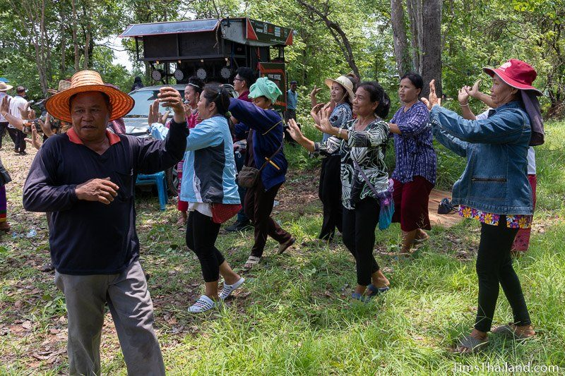 people dancing in front of truck with large PA system