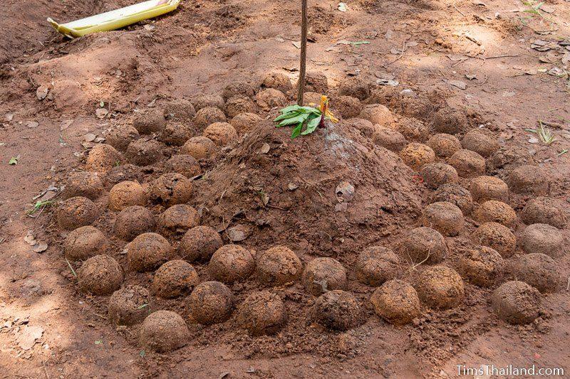 small stupa made of dirt
