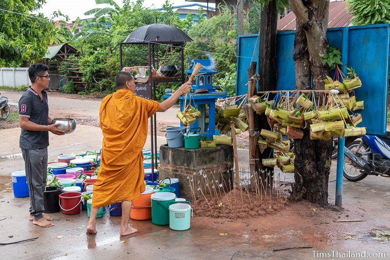 monk splashing water