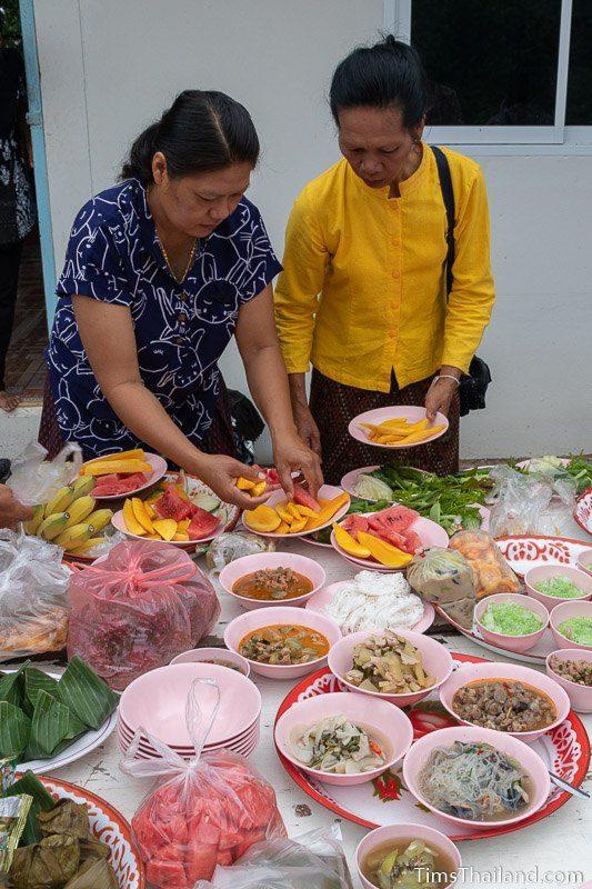 women preparing food trays