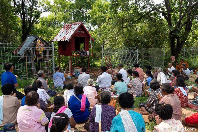 women sitting in front of shrine
