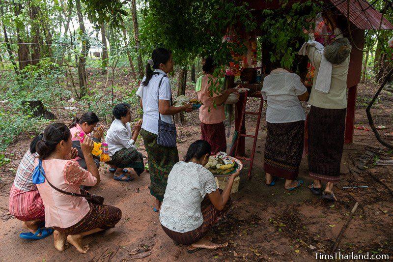 women bringing food to shrine