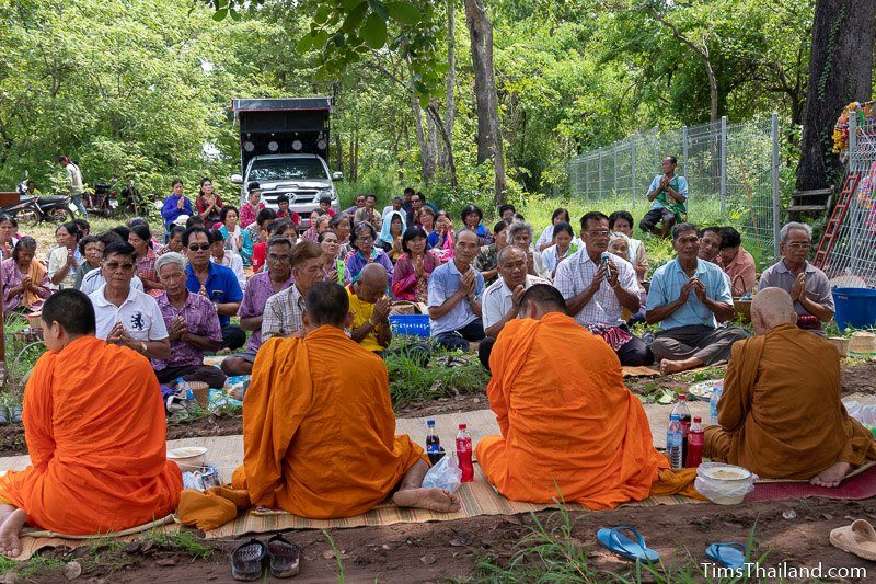people sitting in front of monks