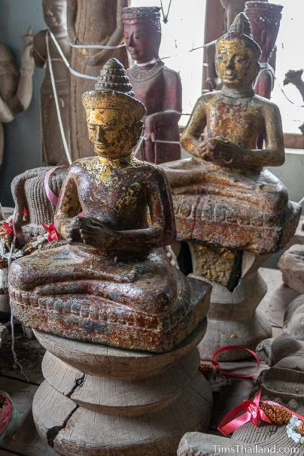 "two Khmer Bhaisajyaguru ""Medicine Buddha"" statues"