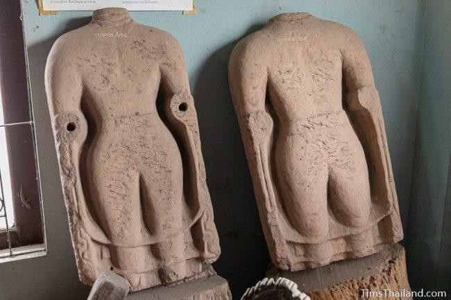 damaged Khmer Buddha statues