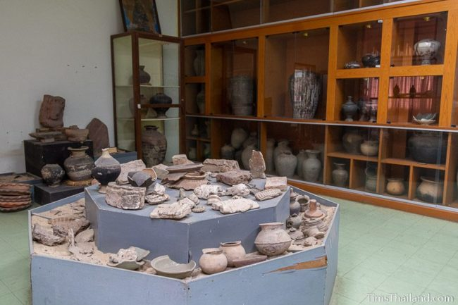 room full of pottery and fragments of stone carvings