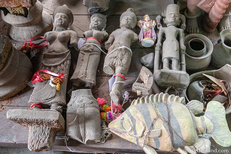 five broken Khmer statues