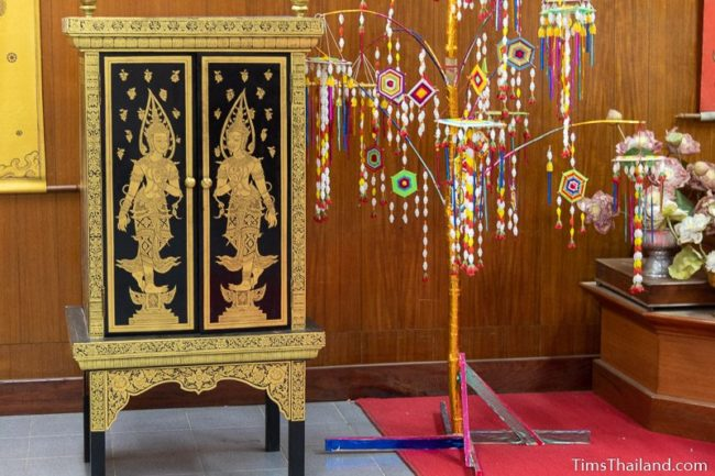 gold-painted cabinet for storing palm leaf manuscripts