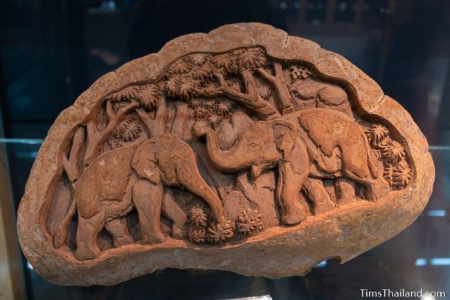 elephants carved onto a large mushroom