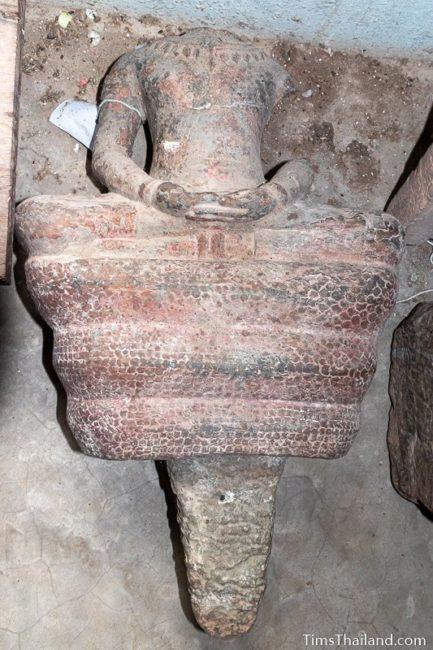 broken Khmer on naga statue