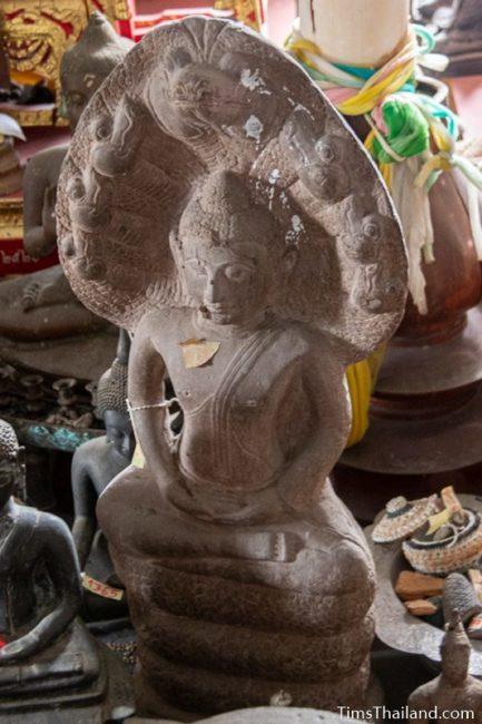 Khmer Buddha on naga statue
