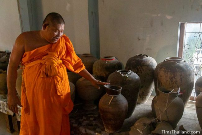 monk showing Khmer pottery