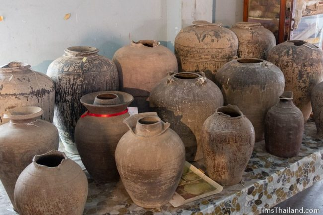 rows of old pots on a table.