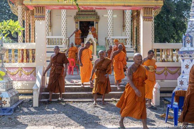 monks walking out of the ubosot